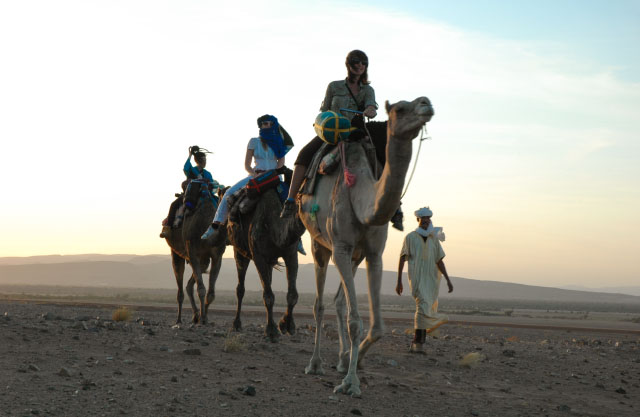 Students camel trekking in the Moroccan Sahara